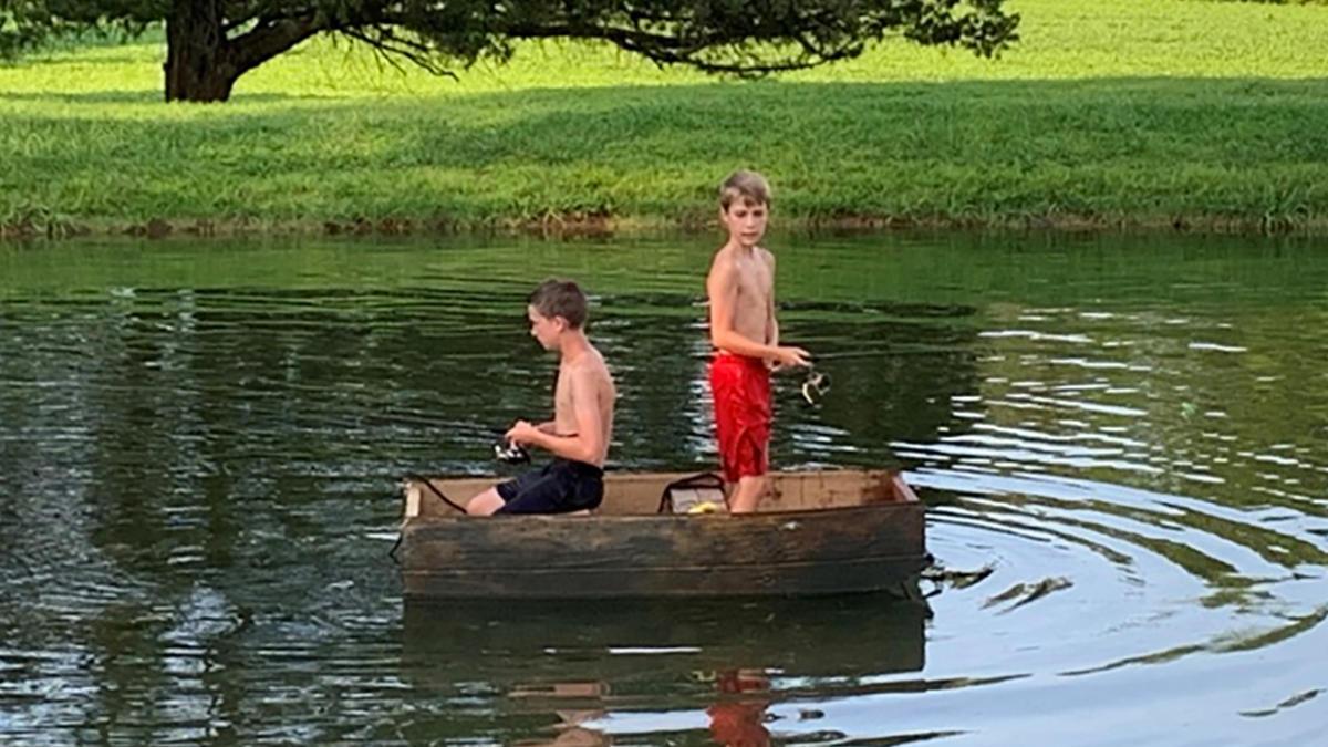 boys-build-fishing-boat-from-scrap-wood-2.jpg